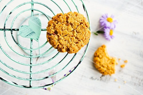 Nut biscuits on a cake stand with flowers