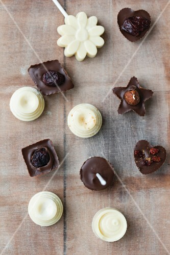Chocolates on stick with homemade pralines with dried fruits