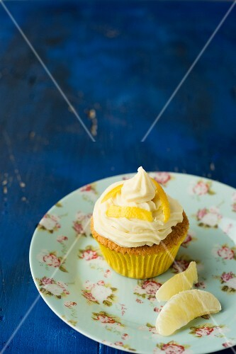 A cupcake with a lemon topping