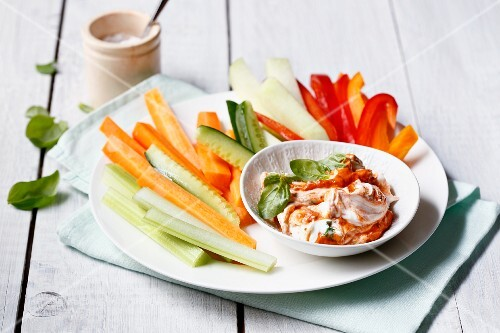 Vegetable sticks with a red pesto dip