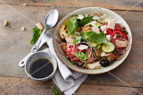 Vegetarian bread chip salad with cucumbers, tomatoes and olives