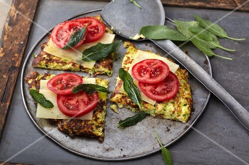 Vegetarian parsnip cakes with cheese, tomatoes and sage