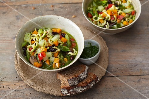 The and vegetable stew with beans, pasta and wild garlic pesto
