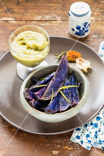 Baked purple potatoes with sauce