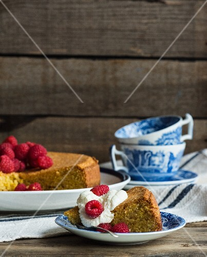 Olive oil cake with raspberries and cream, sliced