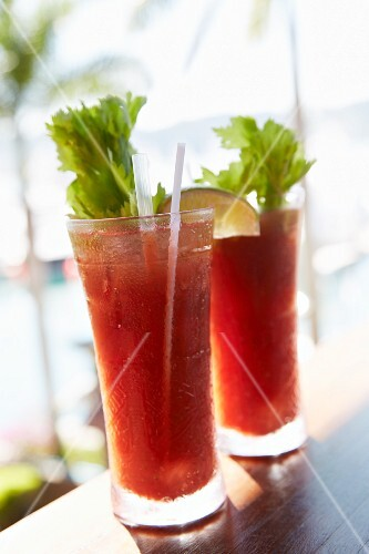 Two Bloody Mary's at a beach bar