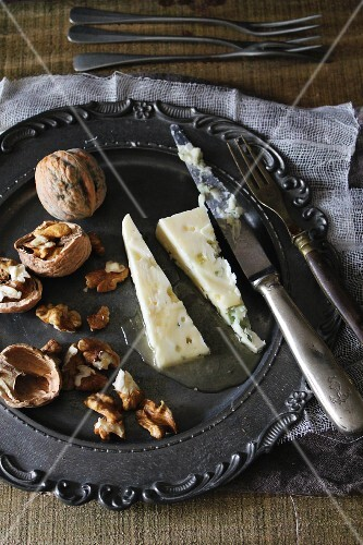 Roquefort and walnuts on a pewter plate