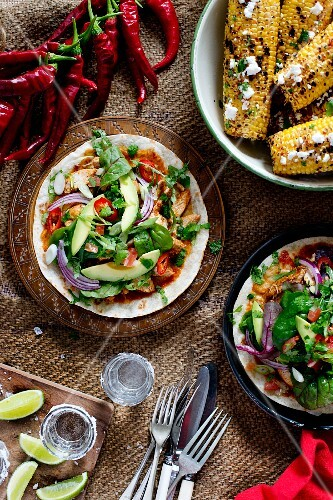 Fajitas with chicken, corn cobs and tequila (Mexico)