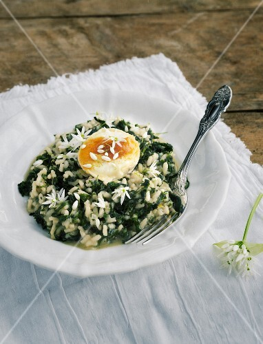 Wild garlic risotto on a white napkin on a wooden table