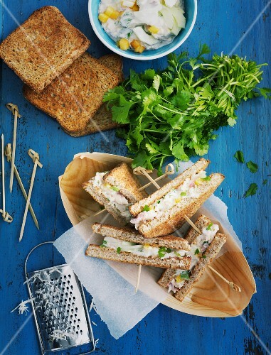 Smoked fish sandwiches on a blue wooden table