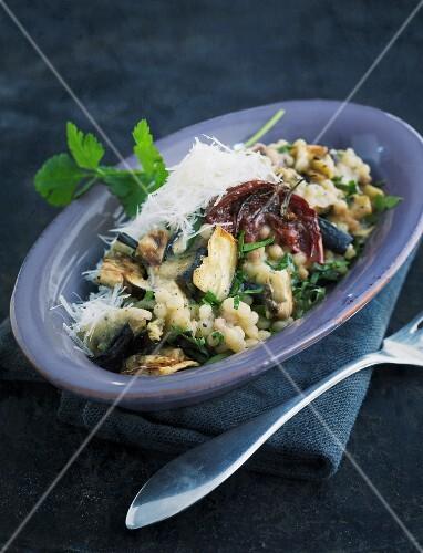 Oven-roasted aubergines with fregola sarda
