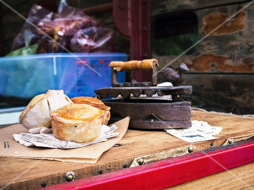 Mini pies for sale on a market stand