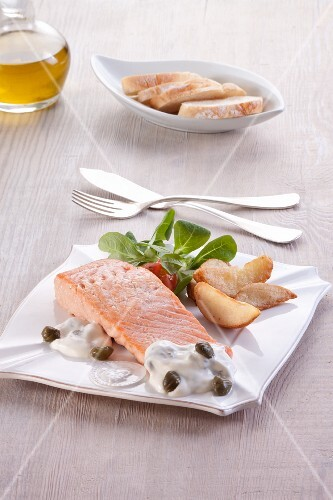 Baked salmon fillet with a caper sauce