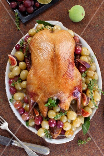 Roast duck with grapes and figs