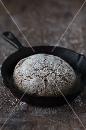 Rustic sourdough bread in a pan