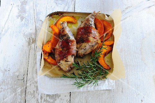 Rabbit wrapped in bacon with pumpkin and rosemary