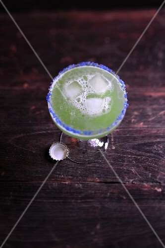 An exotic beer cocktail with kiwi