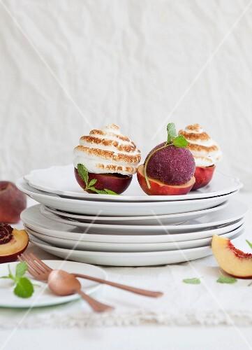Peach Alaskas with berry sorbet