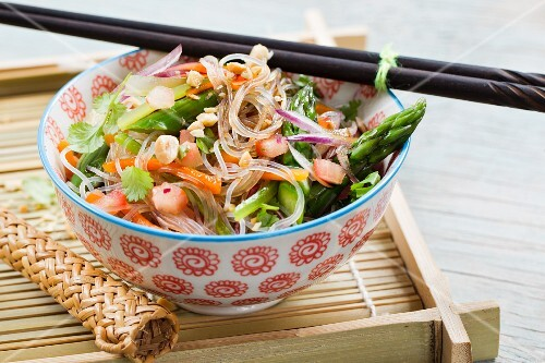 Vegan glass noodle salad with green asparagus, carrots and peanuts