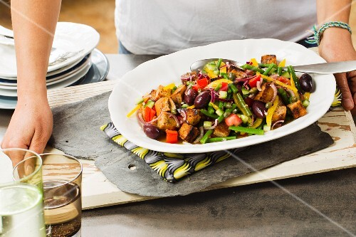 Bread salad with colourful vegetables, olives and capers