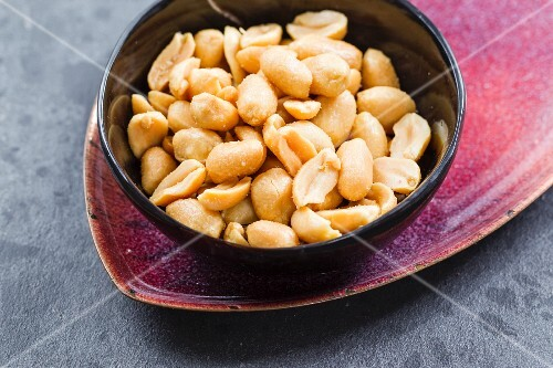 A bowl of roasted, salted peanuts