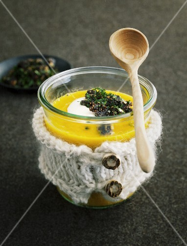 Cream of carrot soup with ginger and parsley crumbs
