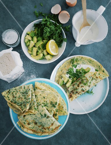Herb pancakes with avocado and rocket