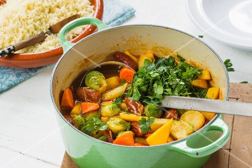 Vegan vegetable ragout with dates served with couscous
