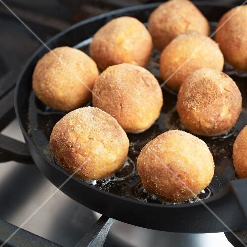 Vegan tofu balls being fried