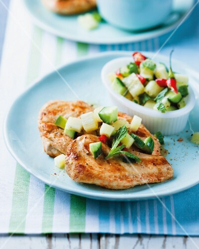 Fried chicken breast with a pineapple salsa