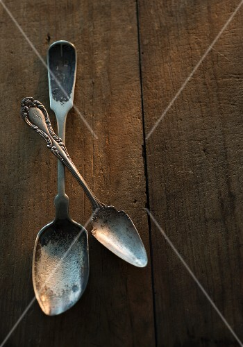 Old spoons on a wooden surface