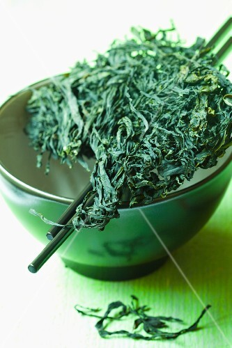 Wakame in a ceramic bowl with chopsticks