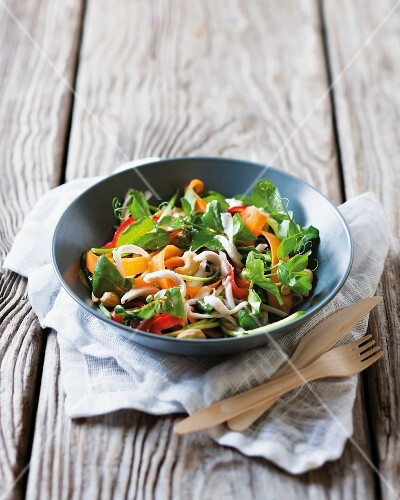 A vegetable salad with coconut strips