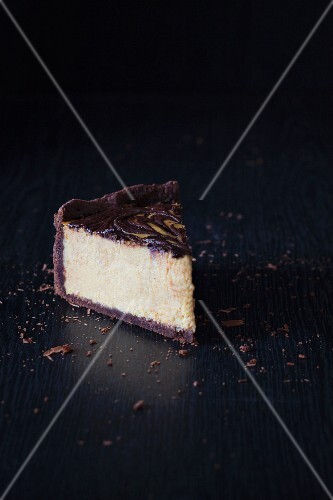 A slice of pumpkin and chocolate cheesecake