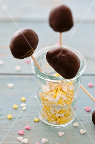 Chocolate lollies in a glass with sugar stars and hearts