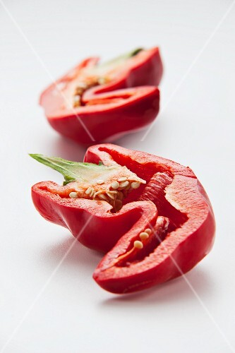 Two halves of a red pepper