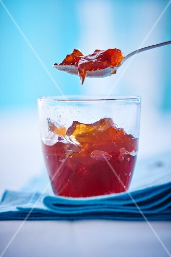 Tea jelly in a glass and on a spoon
