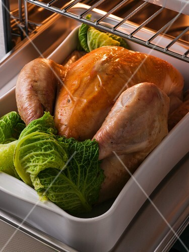 Roast chicken with savoy cabbage in the oven