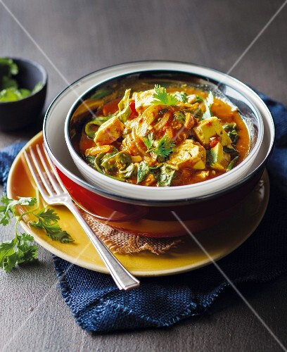 Spicy soup with avocado and coriander