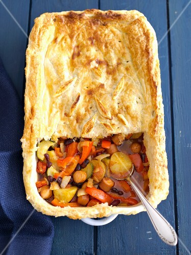Sausage and vegetable bake with kidney beans and a puff pastry topping