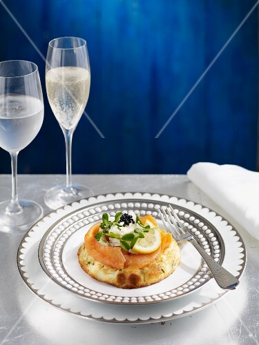 A blini with salmon, sour cream and caviar