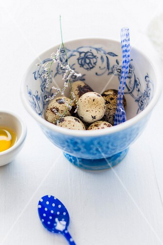 Quail eggs in a floral patterned bowl