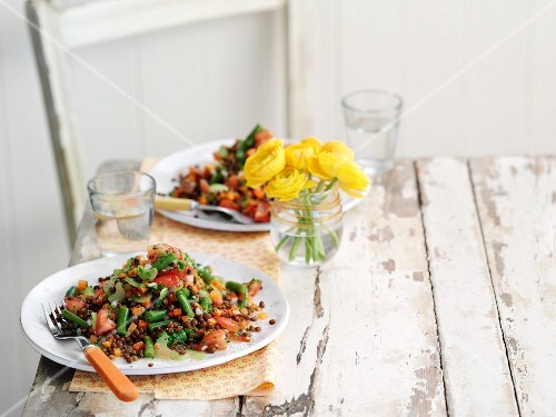 Green bean and lentil salad on a white table