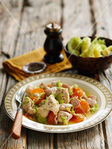 Chicken stew with ham, carrots, celery and mastered