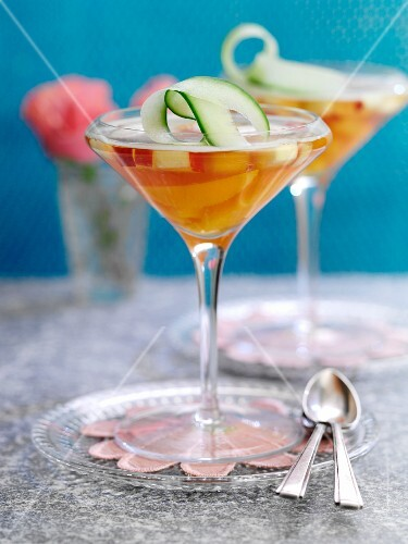 Jelly with Pimms and fruit in champagne glasses