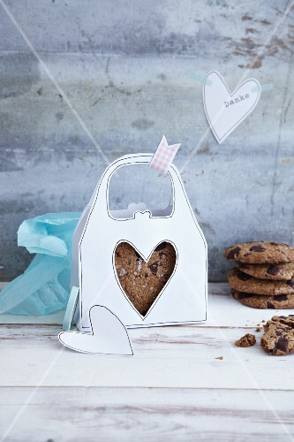 Chocolate chip cookies in a homemade, white paper handbag box