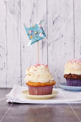 A pinwheel decorating a cupcake