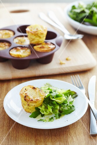 A stack of mini potato cakes with salad