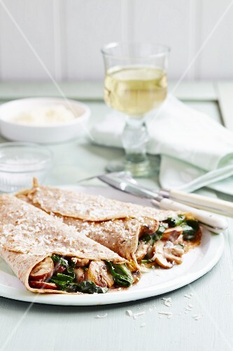 Two savoury crepes filled with mushrooms and spinach