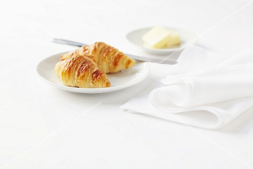 Two croissants and butter